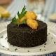 Cuscús negro con chipirones y alioli