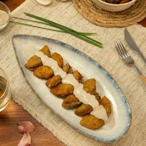 Empanadillas de berenjena con salsa de champiñones